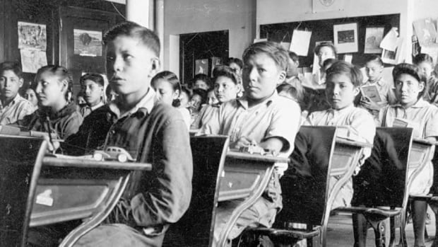 Residential school children students are seen in a typical classroom. Former students will be asked if they want the record of their abuse preserved or destroyed.