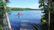 Summer canoe on lake