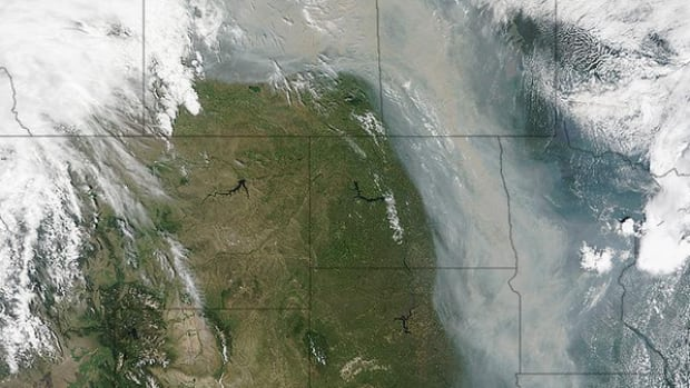 Forest fires in northern Saskatchewan and Alberta create a trail of smoke into the United States.