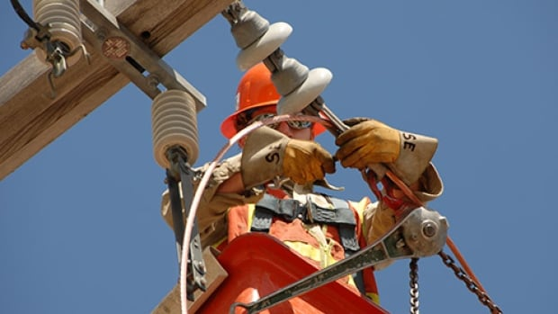 A SaskPower worker repairs a line in this undated photo from the SaskPower website.