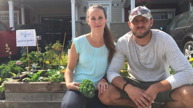 Shannon Lough and Will Needham were originally told by a bylaw officer that they'd have to remove part of their front yard garden by July 30 after a neighbour complained.
