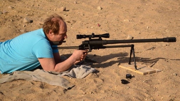Guido Amsel is seen with a firearm in this Facebook photograph.