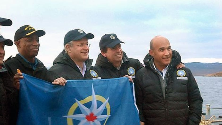 From right, Jim Balsillie, John Geiger, Prime Minister Stephen Harper and Captain Paul Smith, onboard the HMCS Kingston, off the coast of Pond Inlet, in August.