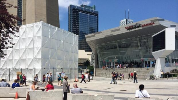 """The cauldron's location was revealed to be at the base of the tower, but the actual image remains hidden behind what officials described as the """"Canada's biggest sugar cube."""""""