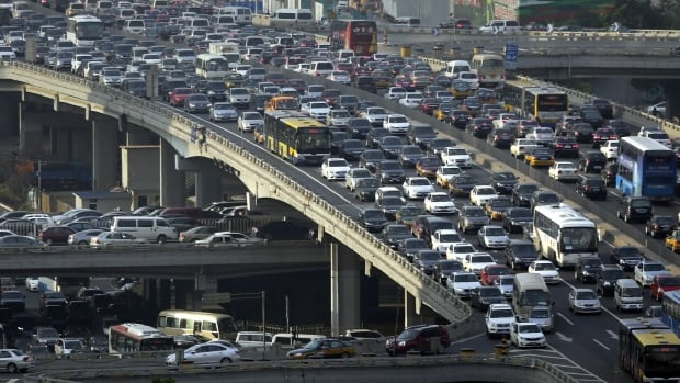 Cars jam up during rush hour in Beijing in 2013. Cities around the world experience traffic jams, but is there an app for that?