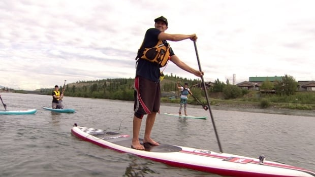 Ten experienced stand up paddleboarders will have the opportunity to enter the 2016 Yukon River Quest. In this image, SUP Yukon owner Stuart Knaack shows paddleboarding technique.