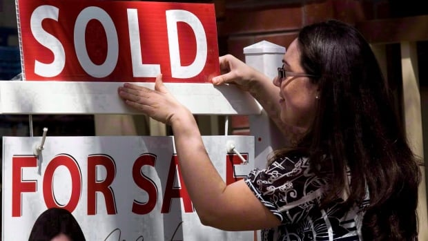 The real estate board says there were 9,989 homes that changed hands in the Greater Toronto Area last month.