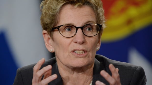 Ontario Premier Kathleen Wynne told a news conference Tuesday her government is considering a request from police chiefs for more power to suspend officers without pay. Current provincial law requires officers to stay on the payroll while suspended, unless sentenced to term of imprisonment.