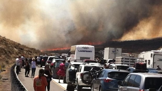 The brushfire swept across Interstate 15 in the Cajon Pass, near San Bernadino, Calif., destroying several vehicles and sending motorists running to safety before burning at least five homes.