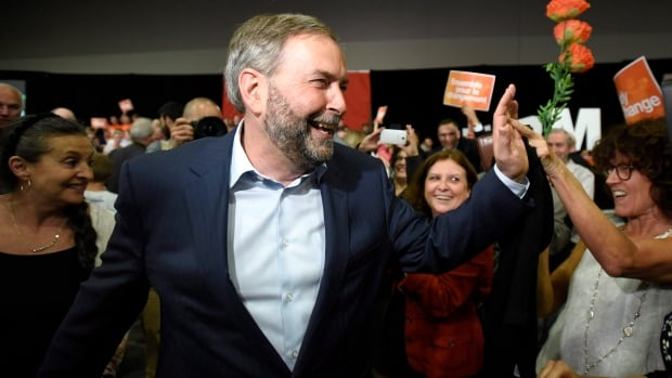 Tom Mulcair thanks supporters at a rally in Ottawa last month. The NDP leader is in Ontario this week on a campaign-style tour to visit key ridings.