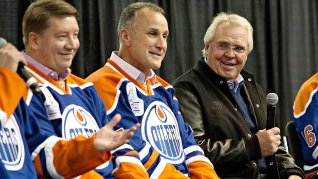 Glen Sather (right), along with Jari Kurri, (left), and Paul Coffey, (middle), in Edmonton on Oct, 8, 2014. Coffey is rejoining the Oilers as skills and development coach, the team said.