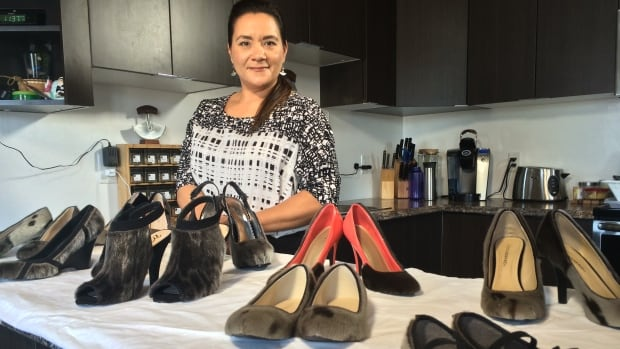 Designer Nicole Camphaug showcases samples of her modern sealskin-covered footware in her Iqaluit home. It all started with her own pair of neglected boots. 'I was going to sell them, but then I thought, 'Hmm... I'm going to try something.'
