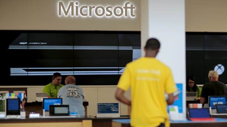 Microsoft posts quarterly loss, writes down Nokia phone
