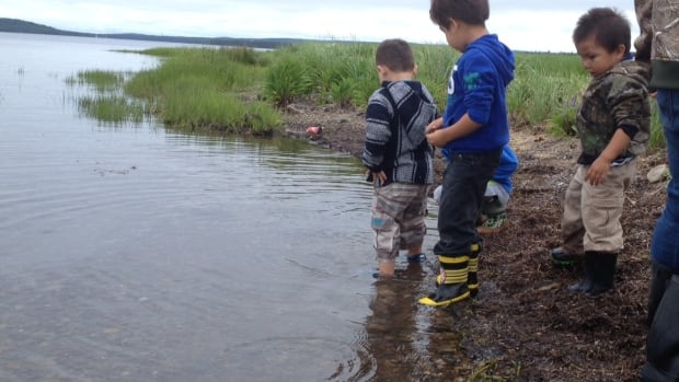 Children play on the coastline of Bras d'Or Lake. A new study shows First Nations communities along the lake are vulnerable to climate change due to rising water and wind.