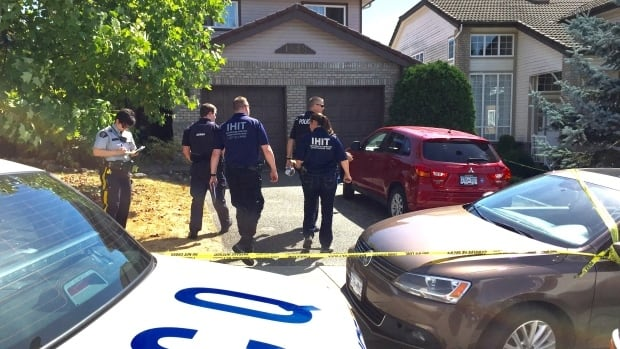 Police investigating the scene on July 16 after two people were found dead in Coquitlam home on Alpine Lane.