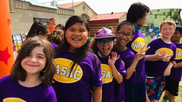 Children and youth attend a recreation and sports funding announcement at Old Exhibition Grounds in Winnipeg on Thursday.
