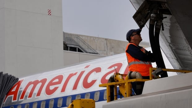 An American Airlines worker refuels a jet with fuel at the Miami airport. The U.S. airline industry uses 45 million gallons of fuel a day, and as such is eager for any alternatives.