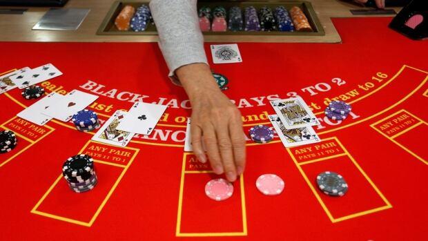 Card table casino AP Photo/Vincent Yu