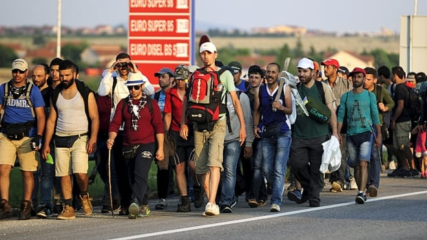 A steady stream of Syrian refugees walk on a motorway at Tabanovce, Macedonia, near the Serbian border last month. Several thousand migrants are crossing the Balkans daily towards Hungary on their way to other European Union countries.