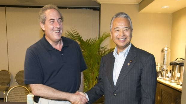 U.S. Trade Representative Michael Froman (left) and Japan's Trade Minister Akira Amari, met Tuesday during meetings for the Trans-Pacific Partnership (TPP) in Lahaina, Maui, Hawaii. Twelve Pacific Rim countries are hoping to reach an ambitious deal representing 40 per cent of the world's GDP.