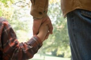 child holding hand