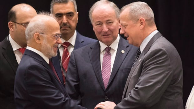 Iraq's Foreign Affairs Minister Ibrahim al-Jaafari (left) shakes hand with U.S. General John R. Allen, special presidential envoy, as Canadian Foreign Affairs Minister Rob Nicholson (centre) looks on, at a meeting of the anti-ISIS Coalition Political Directors, Thursday, July 30, 2015 in Quebec City.