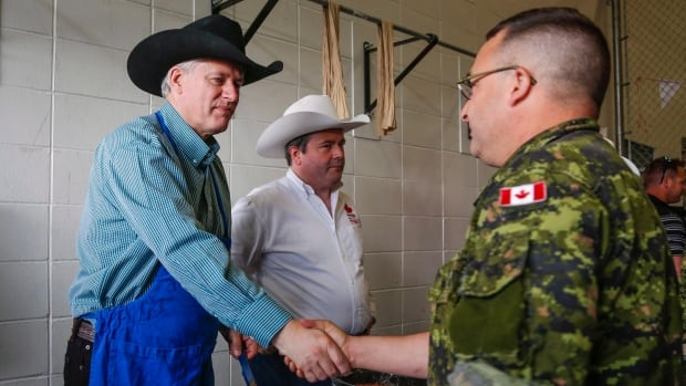 Prime Minister Stephen Harper, seen earlier this month during a Calgary Stampede event serving military families, has been warming up for the election trail for months.