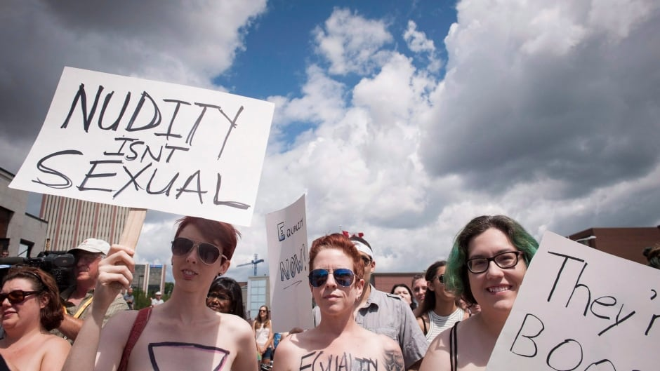 Women march at the first 'Top Free Run' in Kingston, Ont., on July 19, in celebration of a woman's right to bare her breasts. The event commemorated the 26th anniversary of the day when Gwen Jacob took her shirt off on a hot day in Guelph, Ont. — and was charged with indecency.