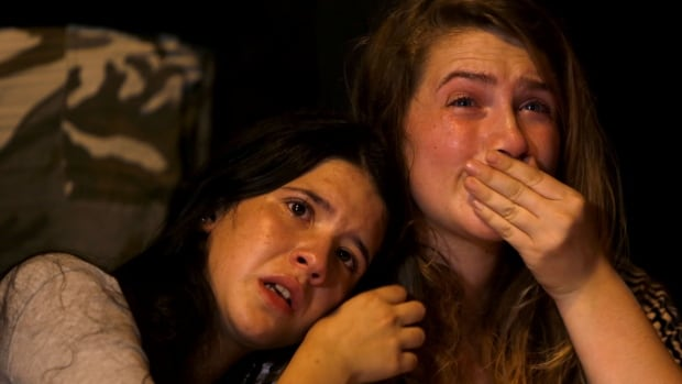 Israeli girls cry during a gathering of hundreds of friends, classmates, teachers, members of the gay community and supporters in downtown Jerusalem to mourn the death of Israeli Shira Banki.