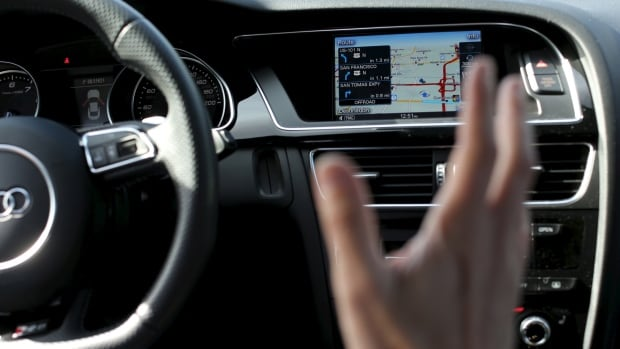 Nvidia's senior director of automotive business  Danny Shapiro displays the electronic dashboard of an Audi automobile in Santa Clara, California in this February 11, 2015 file photo. Federal bureaucrats are raising concerns about distracted driving in semi-autonomous cars that don't require much input from the driver.