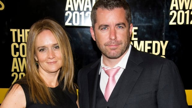Samantha Bee, left, and her husband Jason Jones arrive to The 2012 Comedy Awards in New York. Both credit their careers being kick started by The Daily Show.
