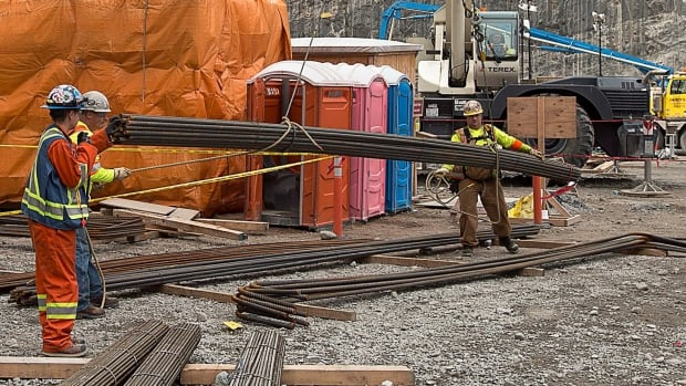 Workers move rebar at the construction site of the hydroelectric facility at Muskrat Falls in this 2015 file photograph.