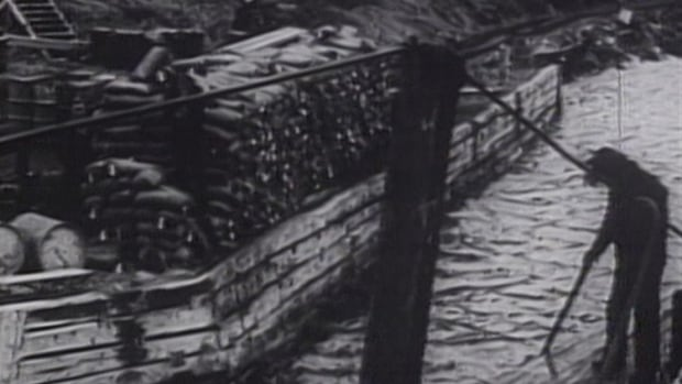 Archival footage shows a barge, loaded with bags of uranium, on the shores of Great Bear Lake. The Dene people of Deline were hired to carry the uranium, which they believe was used in the 1945 bombing of Hiroshima.