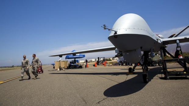 A General Atomics MQ-9 Reaper takes part in a live demonstration of 55 unmanned aerial vehicles, or drones, at a naval base near Oxnard, Calif., last month.