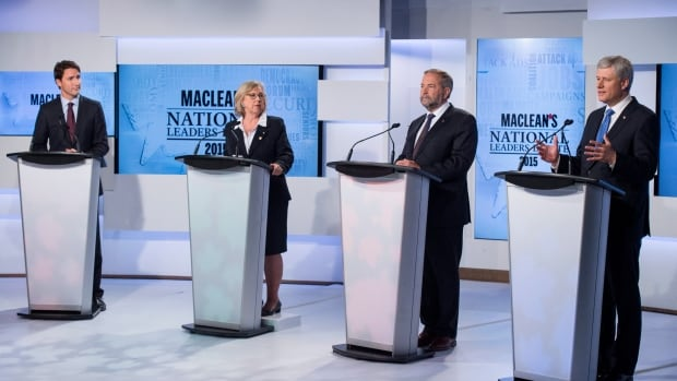 Liberal Leader Justin Trudeau, Green Party Leader Elizabeth May and New Democratic Party Leader Thomas Mulcair listen as  Conservative Leader Stephen Harper speaks during the first leaders' debate Thursday, Aug. 6, 2015 in Toronto.