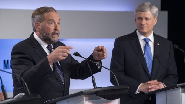 Conservative Leader Stephen Harper, right, listens to NDP Leader Thomas Mulcair make a point during the first leaders debate Thursday, Aug. 6, 2015 in Toronto.