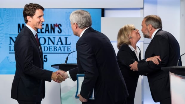Liberal Leader Justin Trudeau, left, shakes hands with Conservative Leader Stephen Harper, as Green Party leader Elizabeth May greets NDP leader Tom Mulcair, right, after the Maclean's leaders' debate Aug. 6. A new poll gives a slight edge to Trudeau and May for their performance.