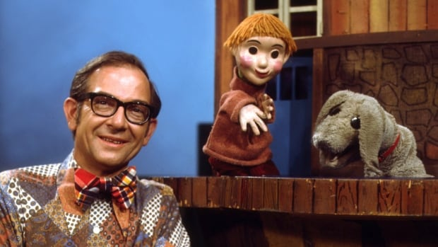 Puppets Casey and Finnegan with Ernie Coombs, who portrayed Mr. Dressup on the iconic children's show.