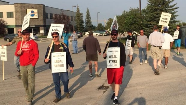 About 15 Burnco employees are picketing outside the plant on Shephard Road in Calgary's southeast this morning.
