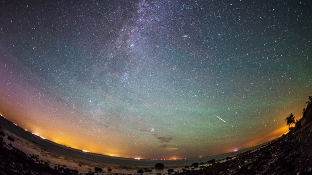 Meteors from the Perseid meteor swarm burn up in the atmosphere over the German island of Fehmarn, Germany, early Aug. 13, 2015. This year, an 'outburst' is predicted to double the number of visible meteors during the peak of the Perseids, Aug. 11-12.