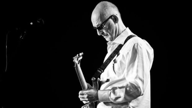 Rock musician Kim Mitchell is recovering in hospital after a heart attack and emergency surgery, according to his management company.