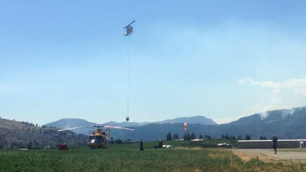Helicopters fighting a wildfire near Oliver, B.C., were grounded because a drone was flying in the area.