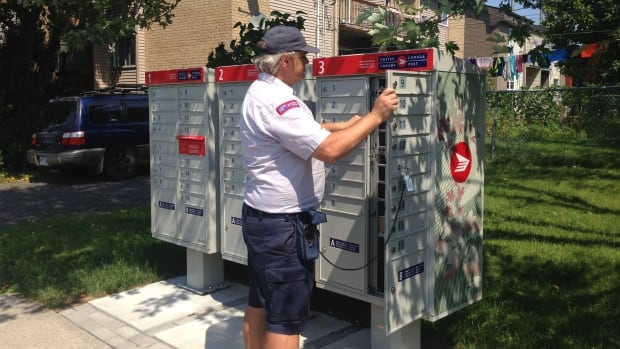 Canada Post says it will hold off on the change to community mailboxes until it has consulted with the incoming Liberal government.