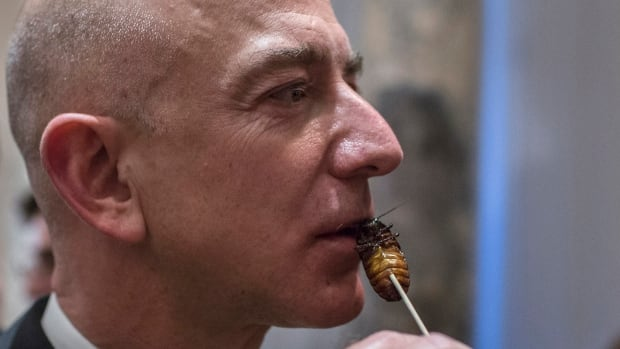 Amazon Chairman and CEO Jeff Bezos samples cooked cockroach at the 110th Explorers Club Annual Dinner at the Waldorf Astoria in New York in March 2014. Over two decades, Amazon has grown from an internet retailer Bezos founded in a garage to an internet juggernaut renowned for innovation.