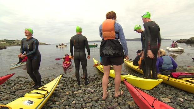 Swimmers and kayak escorts prepare for the 2015 Tickle Swim near Bell Island.