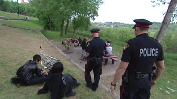 Saskatoon police on a regular patrol along a river park space.