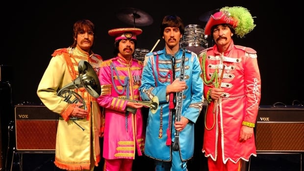 B.C. Beatles tribute band Fab Fourever assembled in the Sgt. Pepper-era attire. Left to right: Kevin Davey as John Lennon, Paul Kaszonyi as Ringo Starr, Jody Tennant as Paul McCartney and Charles Boname as George Harrison.