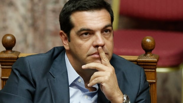 Greek Prime Minister Alexis Tsipras attends a parliamentary session in Athens on August 15. Tsipras has remained silent on whether he will call an early election as he deals with rebels within his own political party.