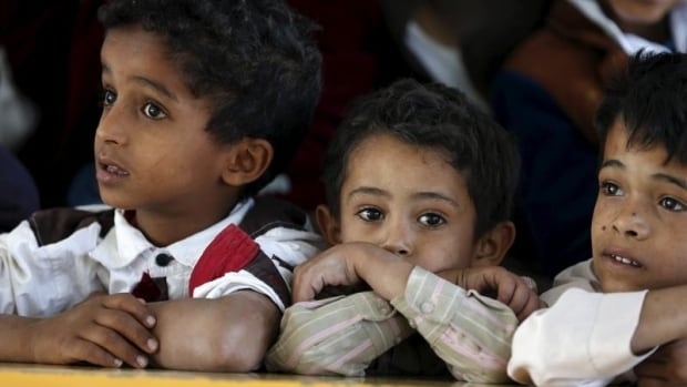 Boys who fled with their families from Yemen's war-torn Houthi-controlled northern province of Saada attend a party at a school sheltering them in Yemen's capital Sanaa on Aug. 22.