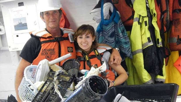 Mega Expedition crew members Mario Merkus, left, and Serena Cunsolo on mother ship R/V Ocean Starr show some of the garbage they skimmed usinga six-metre-wide net for one hour in the Great Pacific Garbage Patch.